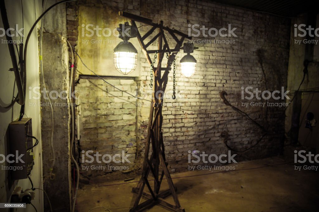Lamp Post With Rusty Lanterns In Corner Of Deserted Building royalty-free stock photo