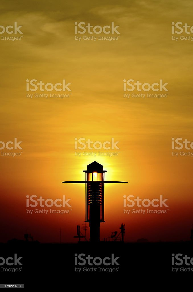 Lamp post with sunset royalty-free stock photo