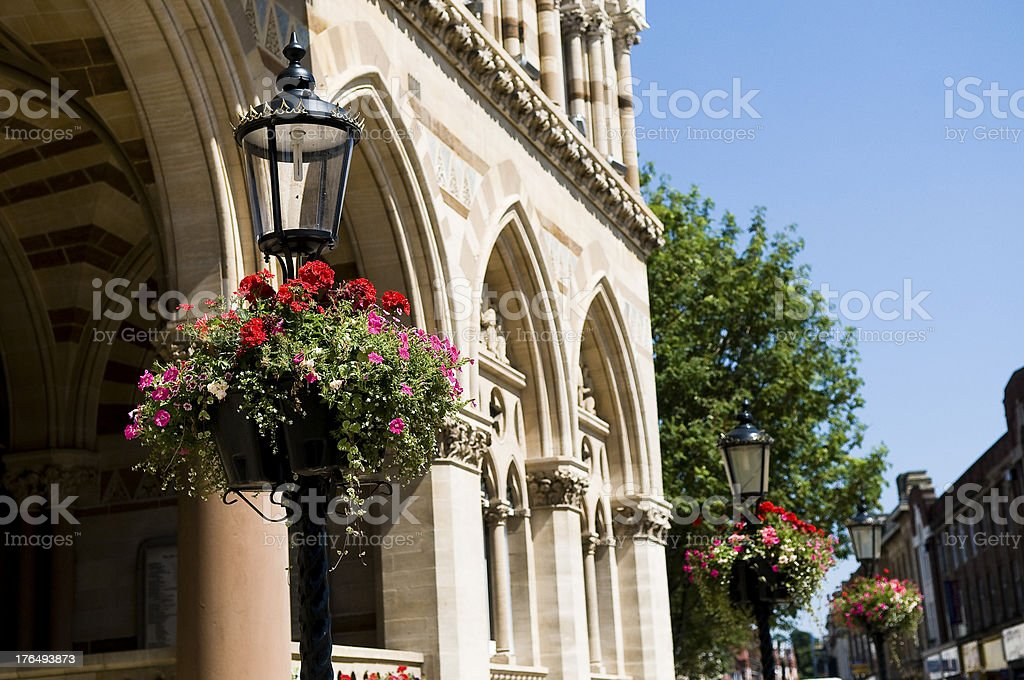 Lamp posts and flowers Guildhall stock photo