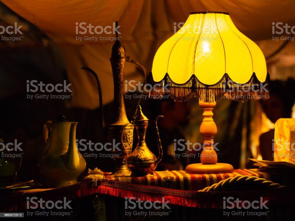 Lamp shining on beautiful eastern metal teapots zbiór zdjęć royalty-free