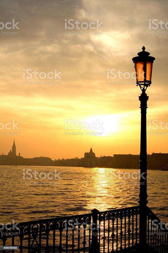 Lamp, Sunrise, and Reflection stock photo