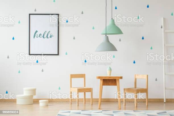 Lamps above wooden table and chairs in bright kids room interior with picture id999859024?b=1&k=6&m=999859024&s=612x612&h=dnepyfvuhzojhpi1pjzxc1h5vd5rpjau05l bxq1zfe=