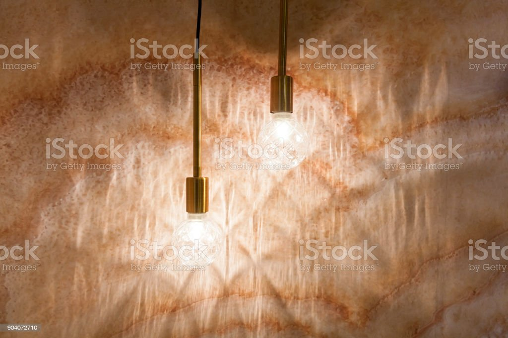 Lamps on the background of a beige wall. stock photo