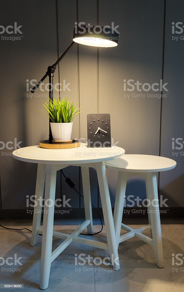 Lamps, plants in pots, table clocks. stock photo