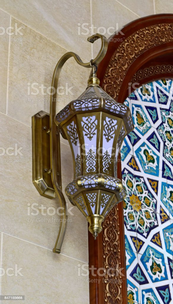 A  lampshade on the wall with patterns. stock photo