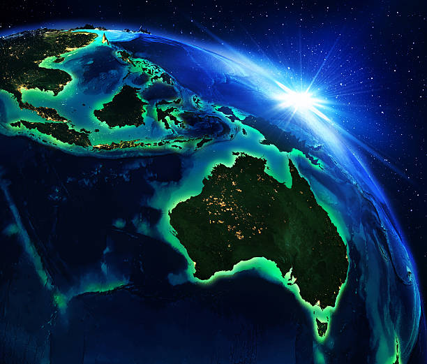 land area in australia, and indonesia the night - singapore nature stock photos and pictures