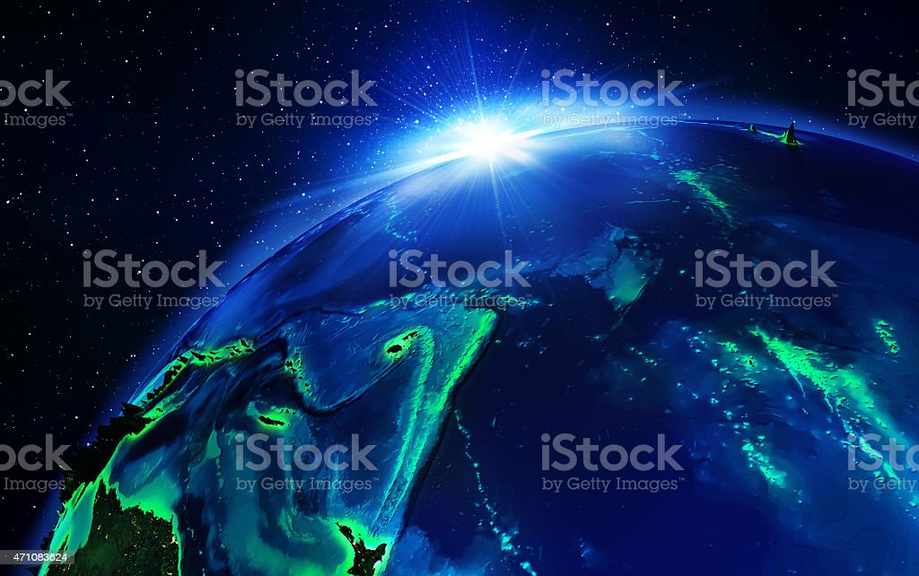 Земель в Тихий океан в ночное время стоковое фото