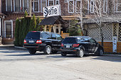 istock Land Cruiser Prado from Toyota, and Mercedes b200. The car is parked near the cafe. 937134888