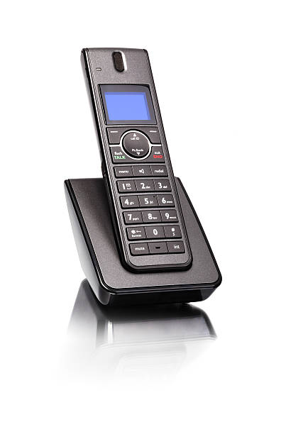 Land line phone Modern cordless land line telephone sitting in charger base cordless phone stock pictures, royalty-free photos & images