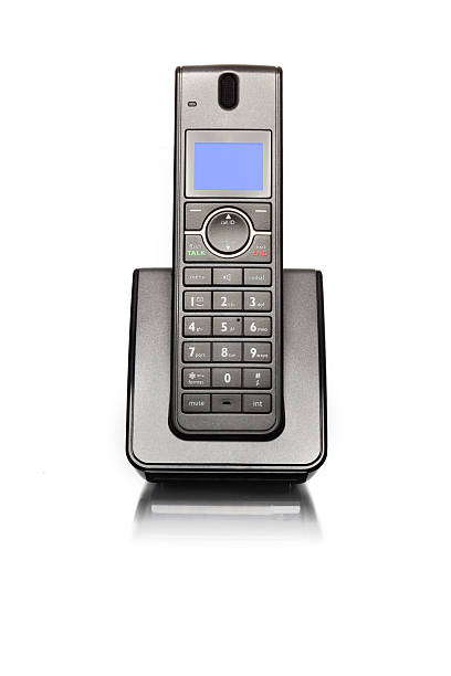 Land line telephone Modern cordless land line telephone sitting in charger base cordless phone stock pictures, royalty-free photos & images