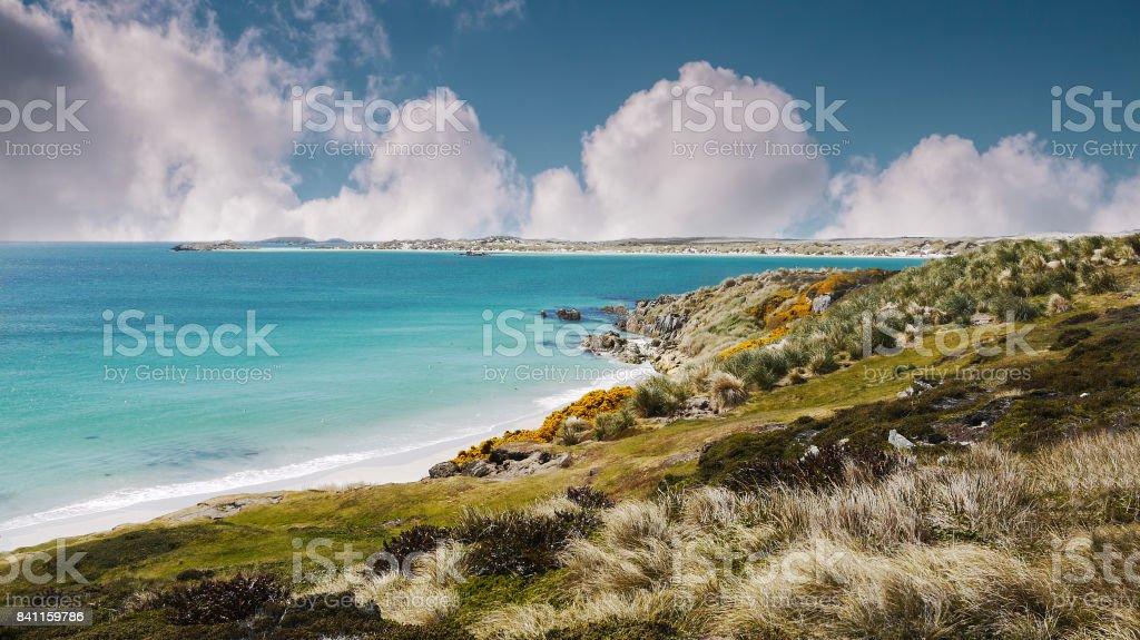 Land mine area on white sandy beaches and coastal Falkland Islands remaining from Falklands War. stock photo