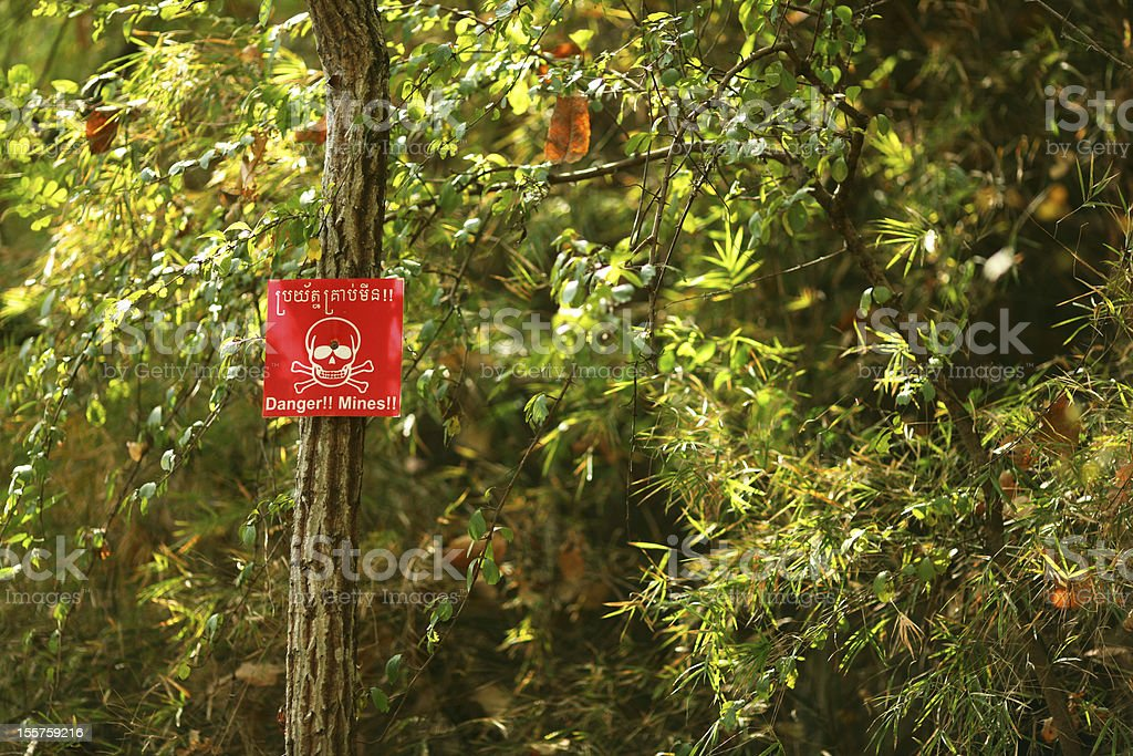 Land mine sign in the woods of Cambodia stock photo
