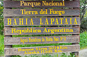 The Tierra Del Fuego sign marking the beginning of the road that transverses North and South America ending in Alaska USA.