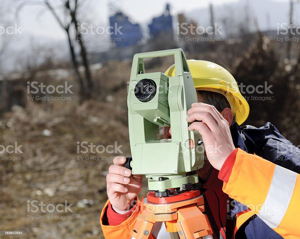 land surveyor calculating royalty-free stock photo
