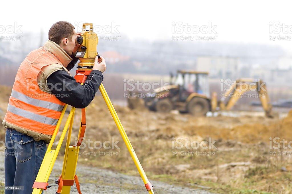 Land surveyor on construction site stock photo
