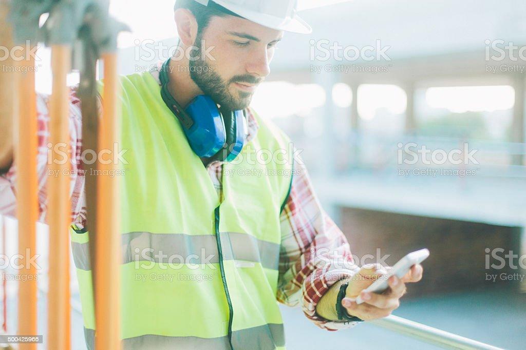 Land surveyor using app on smart phone. stock photo
