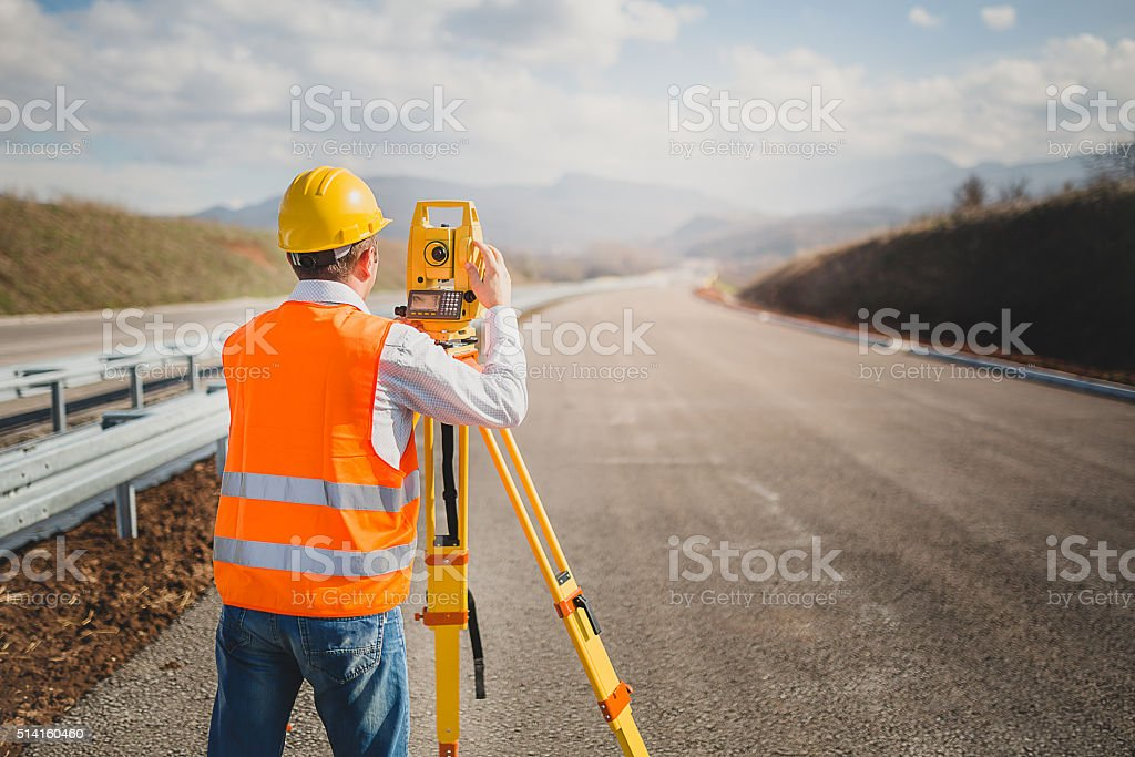 Land surveyor with total station stock photo