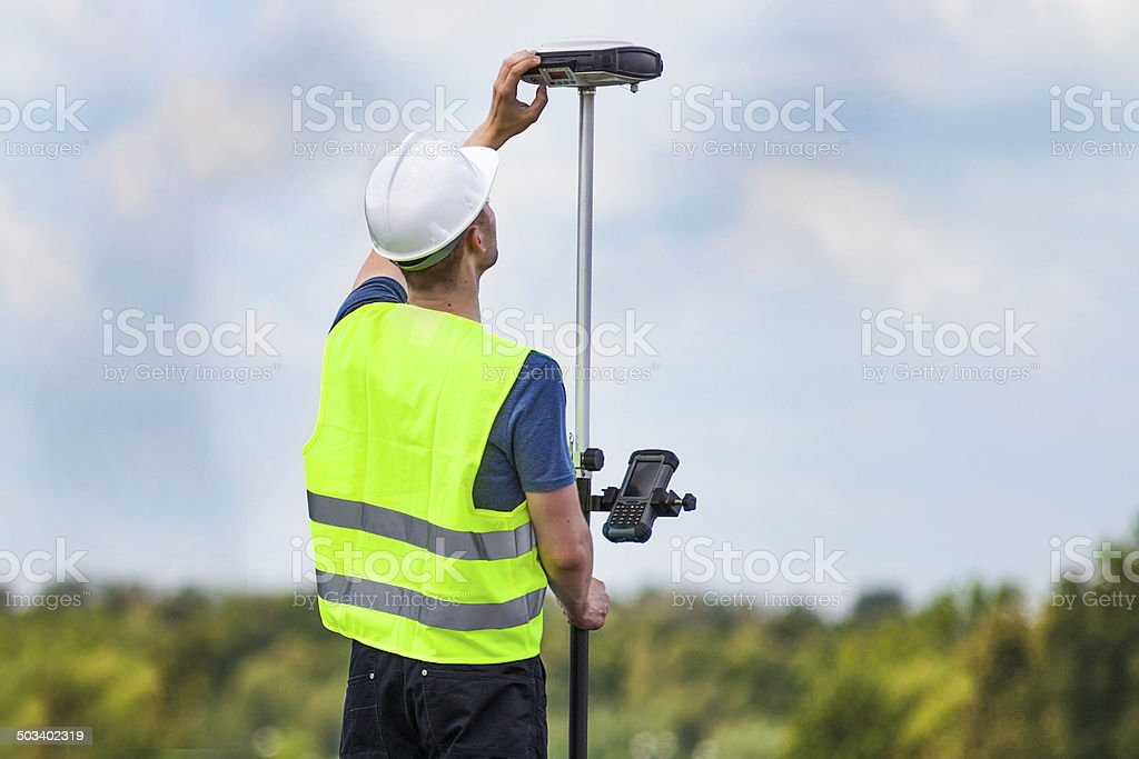 Land surveyor working with a GPS unit stock photo