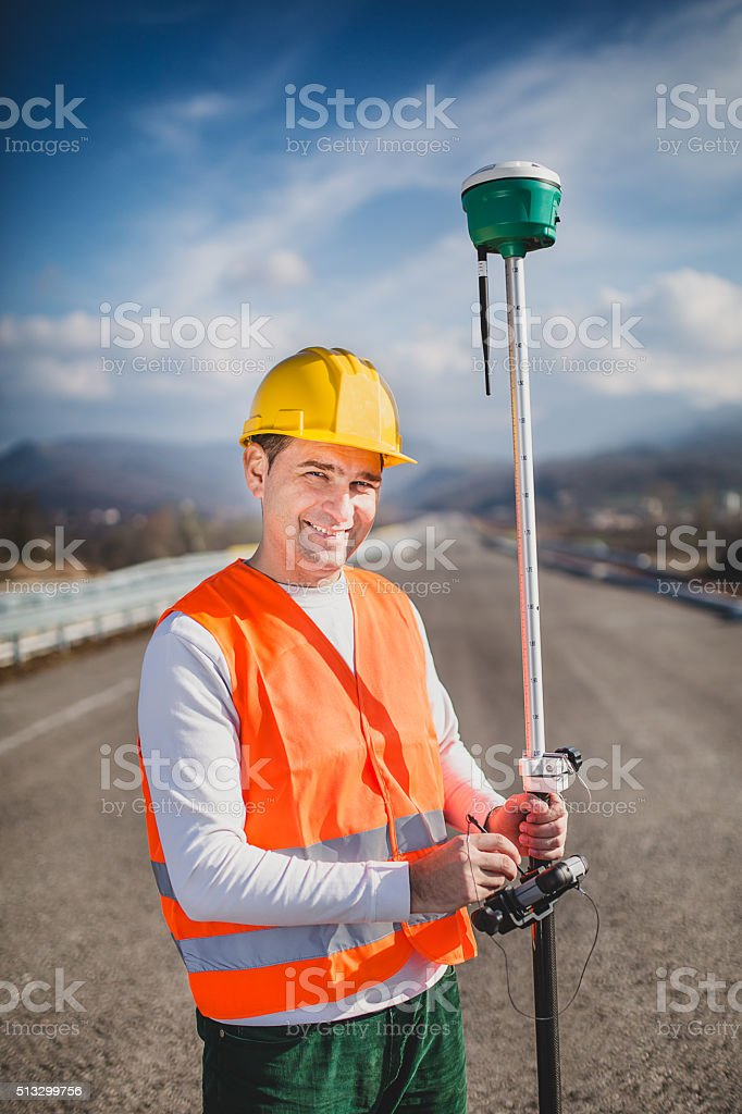 Land Surveyor Working With A Gps Unit Stock Photo - Download Image