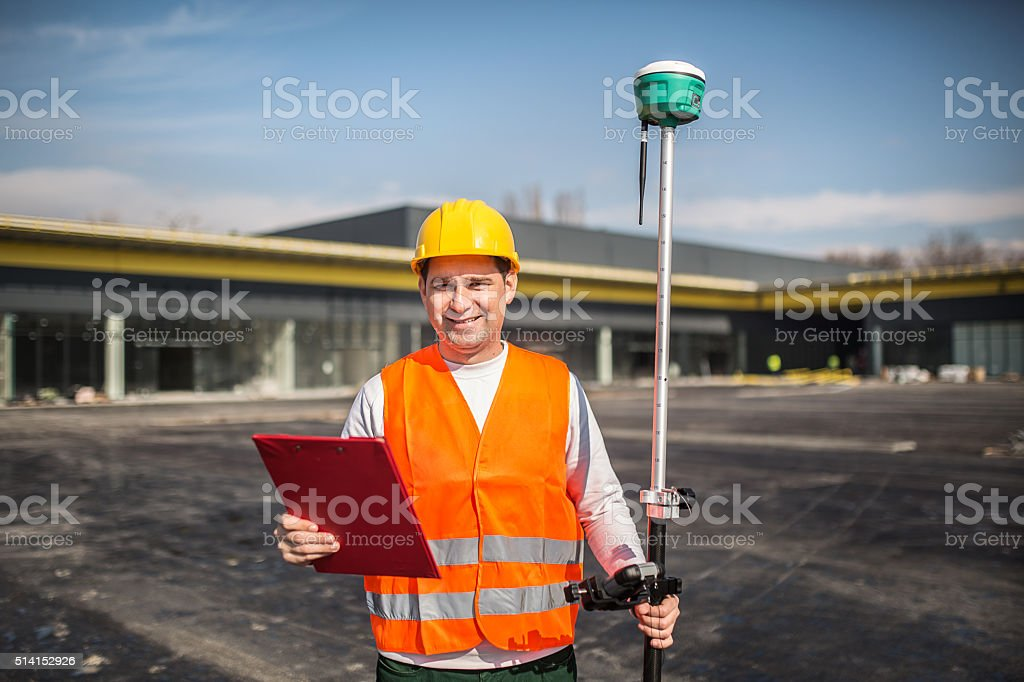 Land Surveyor Working With A Gps Unit Stock Photo & More Pictures of