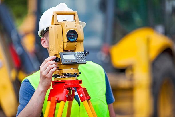 Land surveyor working with a total station. stock photo