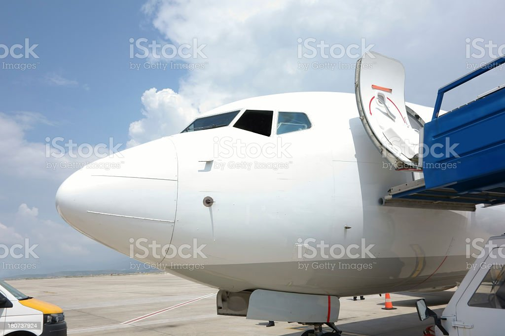 detail of a landed airplane taking ground service,