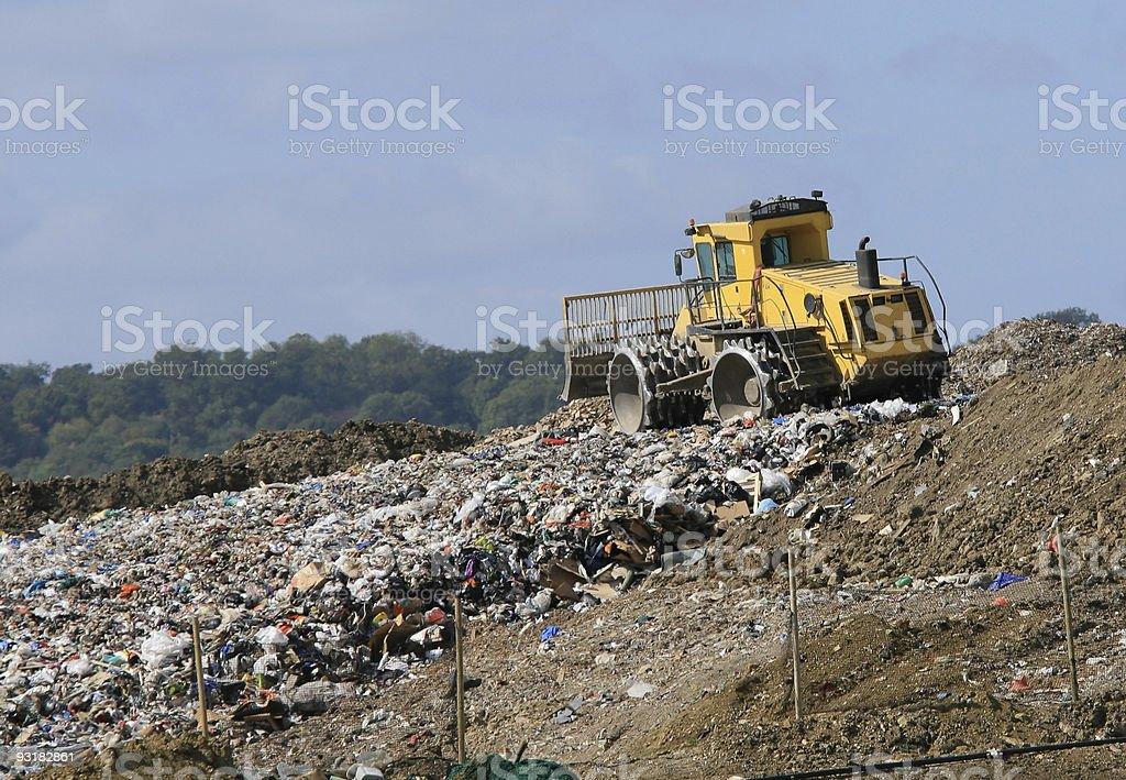 Landfill garbage bulldozer royalty-free stock photo