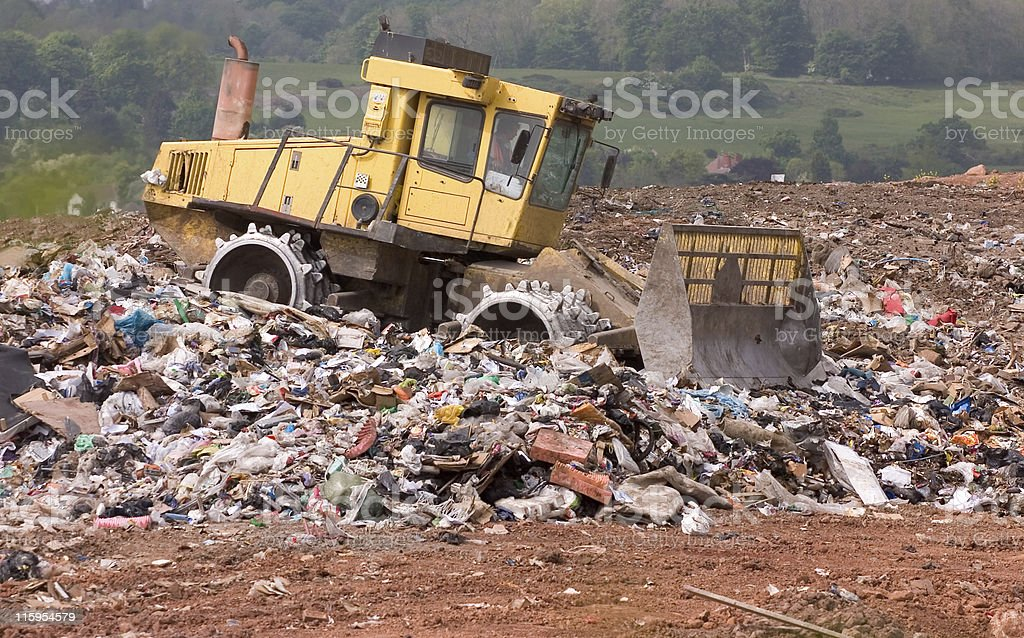 Landfill garbage bulldozer processing waste on a UK rubbish site stock photo