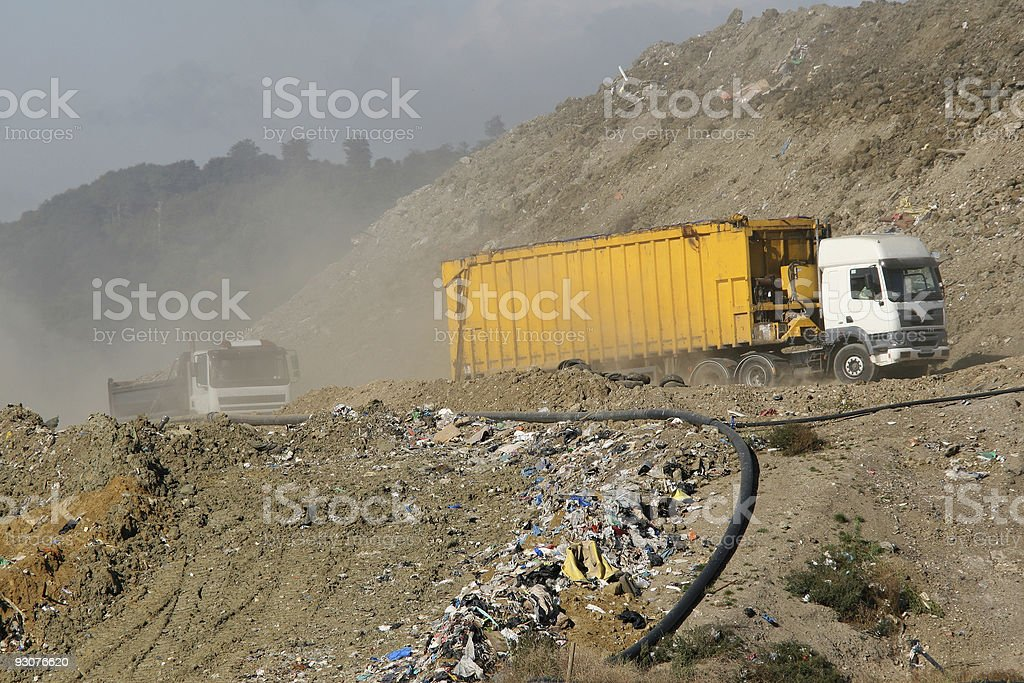 Landfill Garbage Truck And Soil Lorry Driving Through Dump