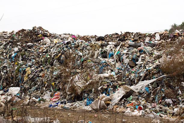 landfill in ukraine, piles of plastic dumped in . the roads - windbeutel stock-fotos und bilder