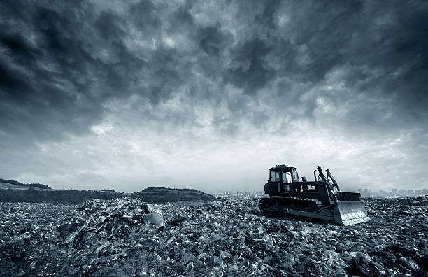 Landfill Transportation over the daily garbage piled garbage landfill. compactor stock pictures, royalty-free photos & images