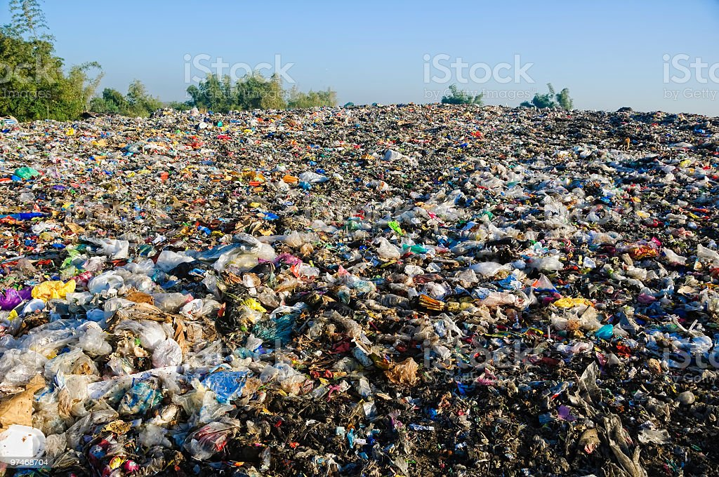 Landfill with lots of trash and garbage stock photo