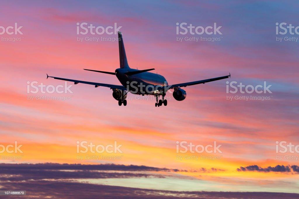 Landing airplane during sunset - Barcelona 'El Prat Aeroport Pau casals' stock photo