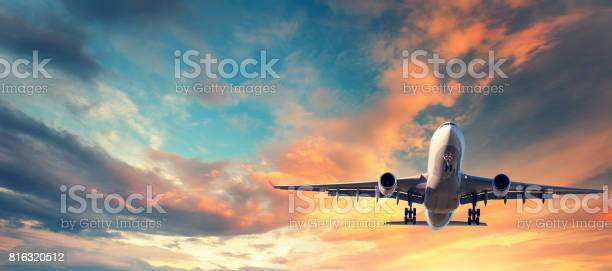 Landing airplane landscape with white passenger airplane is flying in picture id816320512?b=1&k=6&m=816320512&s=612x612&h=akh ktlqloul50xgqsdoz2drfo6qtapvg1yizrg88sy=
