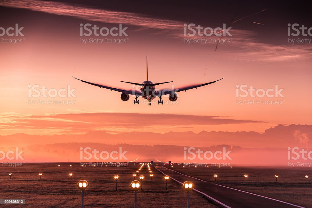 Landing airplane stock photo