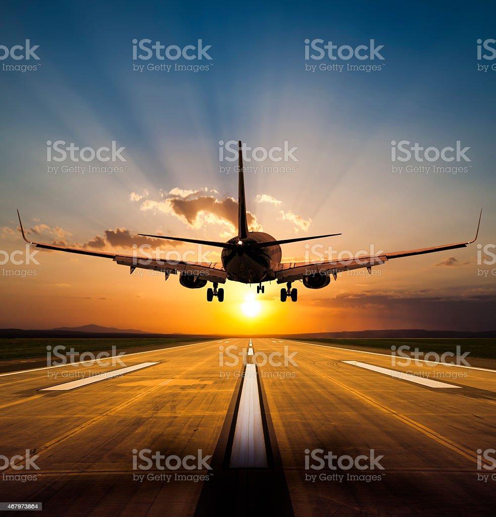 Landing at sunset stock photo