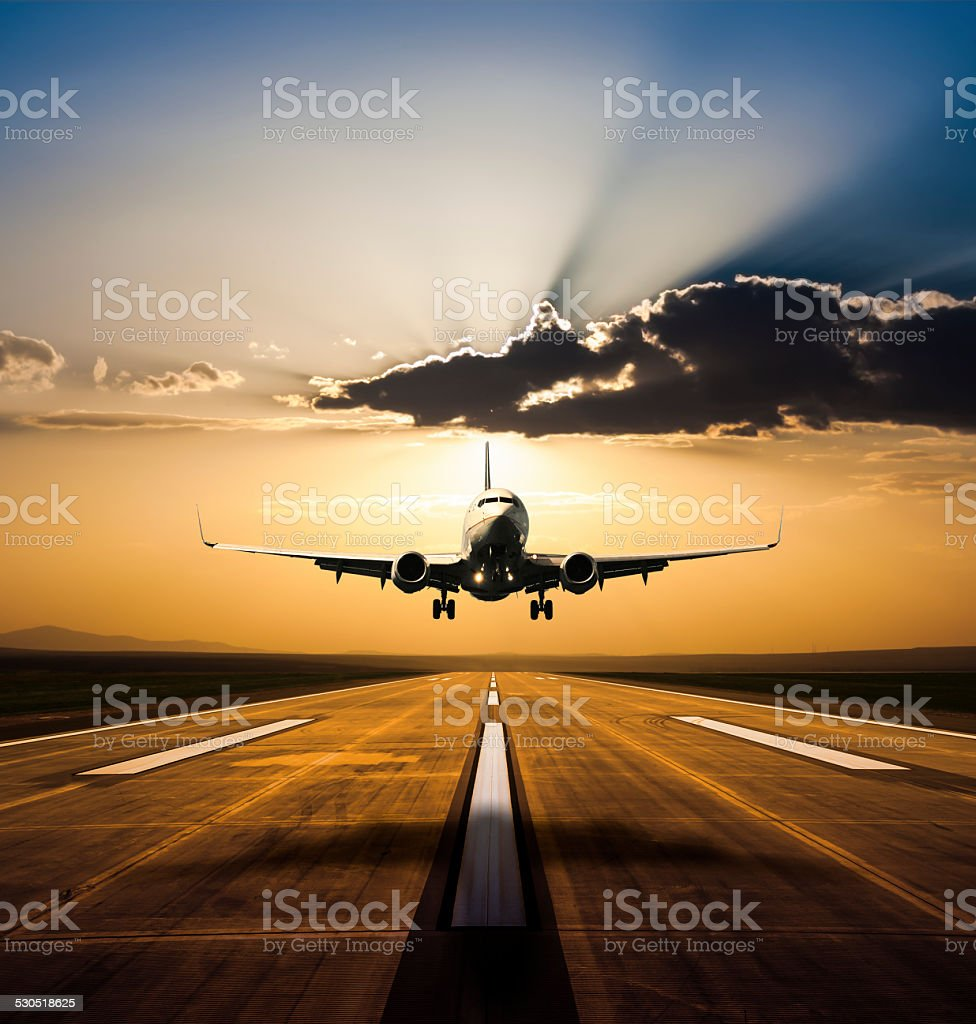 Landing at sunset stock photo