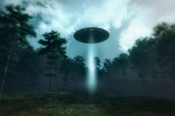 ufo landing in the forest meadow - ufo stockfoto's en -beelden