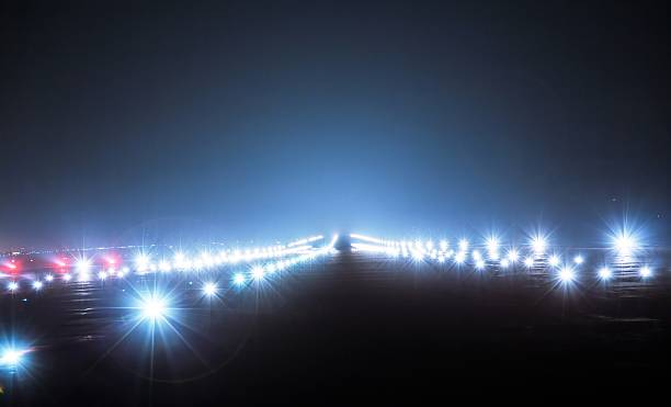 Landing lights at night Landing lights at night closeup airfield stock pictures, royalty-free photos & images
