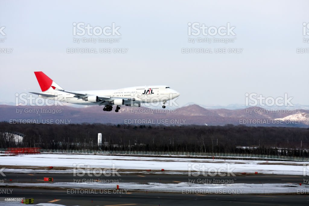 Landing of B747-400 JAL airplane at New Chitose Aairport Sapporo royalty-free stock photo
