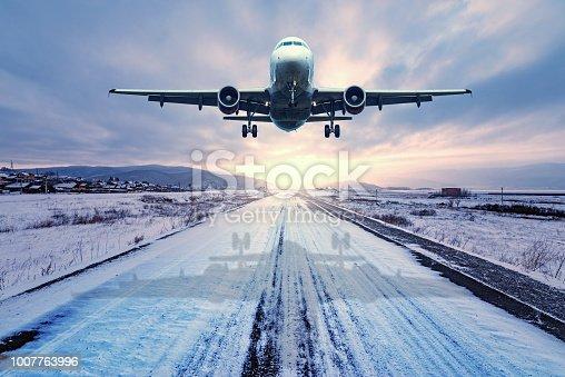 istock Landing of the passenger plane. 1007763996