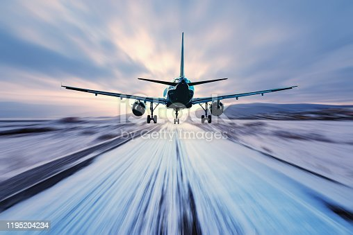 istock Landing of the passenger plane to the highway. 1195204234