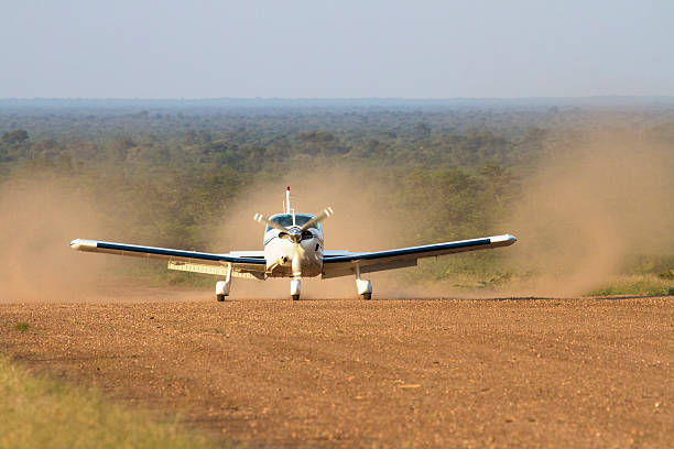Landing on a bush airstrip in Botswana An aircraft landing on a remote dirt airstrip deep in the Botswana bush somewhere between Gabarone and Makgadikgadi. airfield stock pictures, royalty-free photos & images