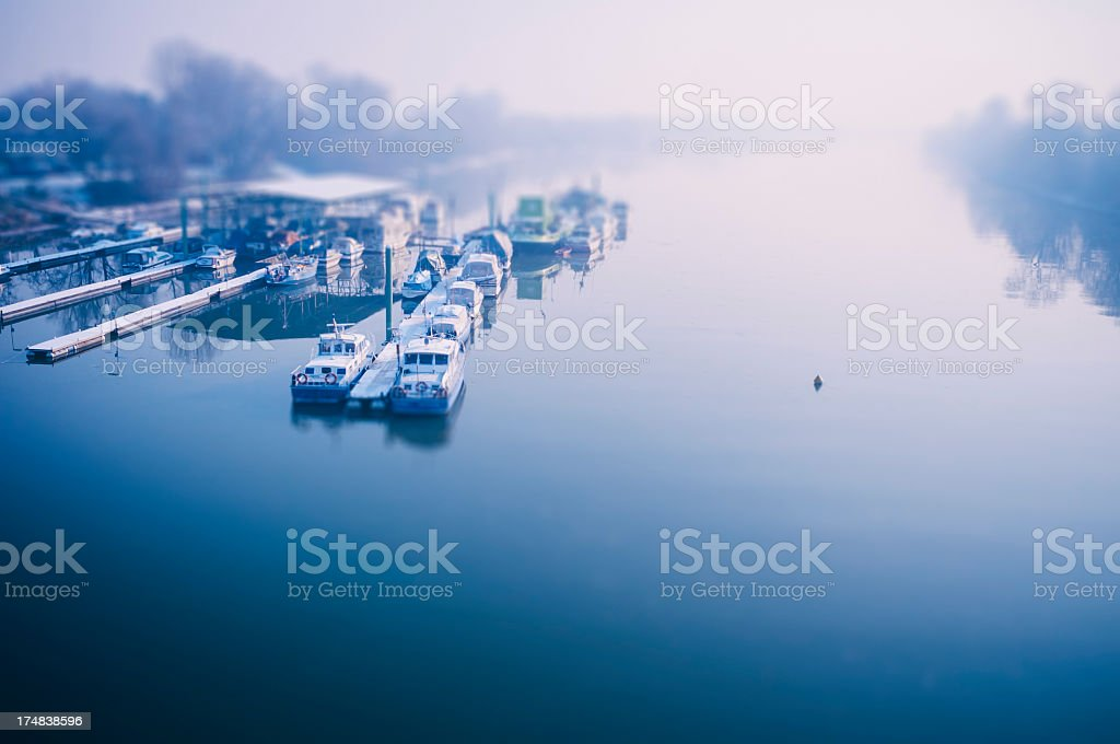 Landing stage in misty morning light on the Rhine royalty-free stock photo