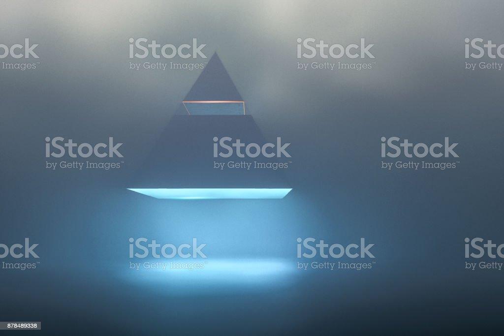 Landing UFO pyramid in foggy night stock photo