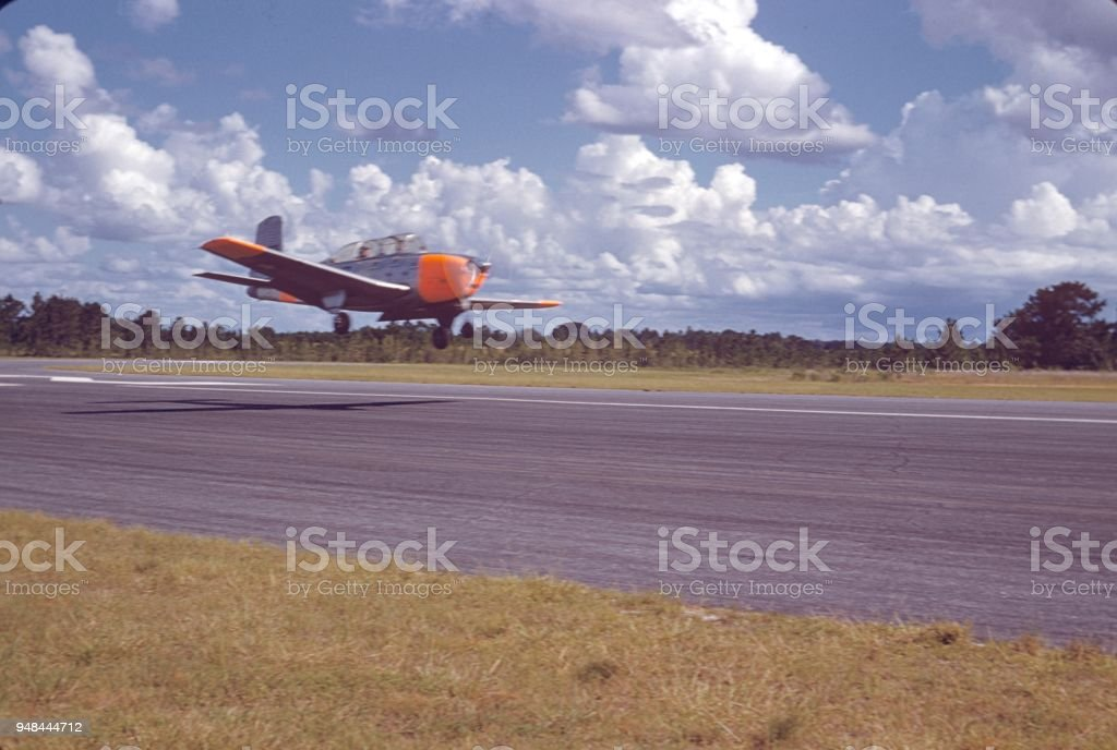 Landing with a propeller plane stock photo