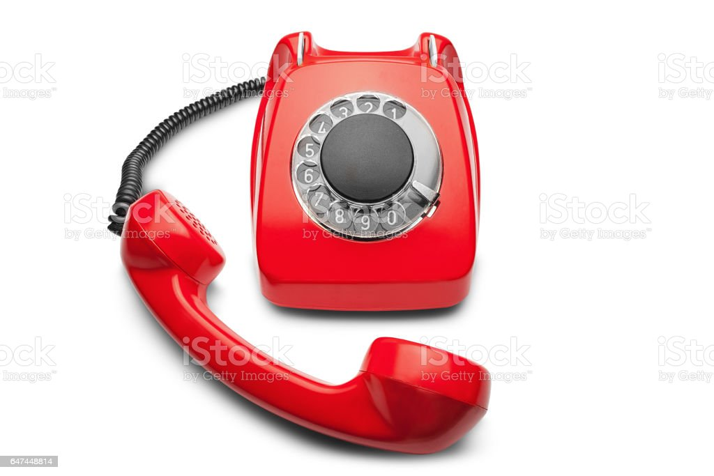 landline red  phone on a isolated white background stock photo