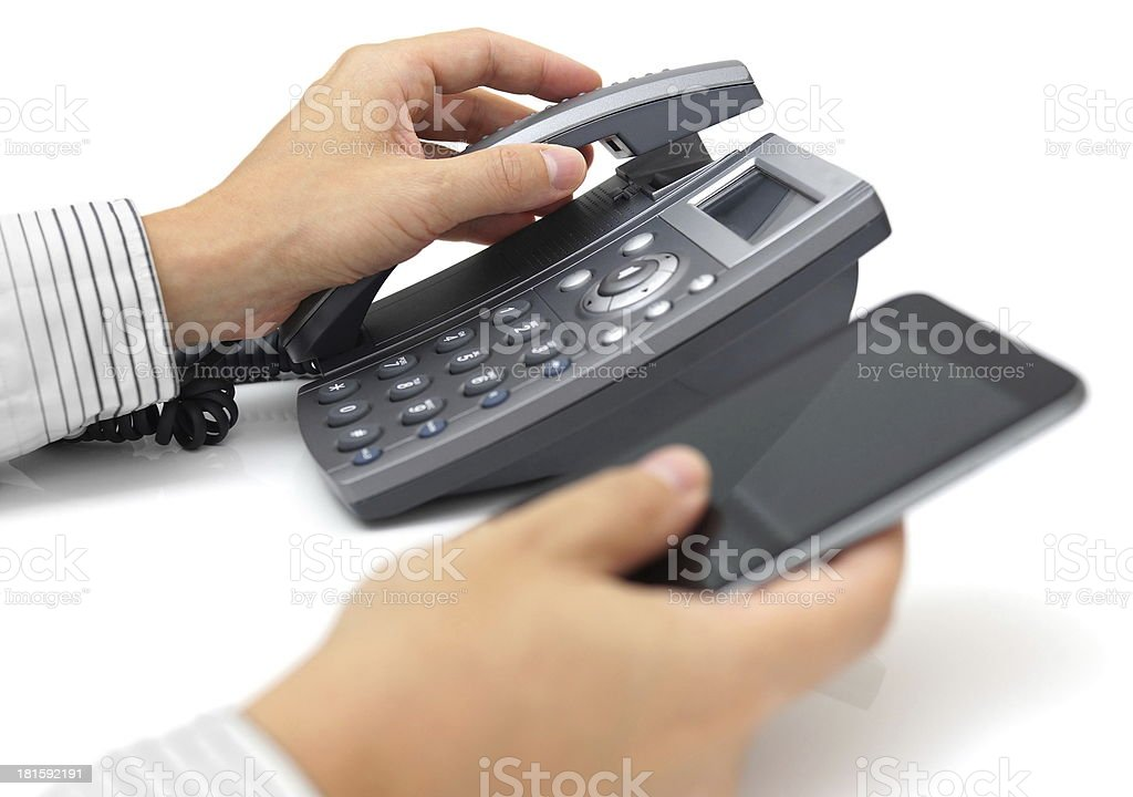 landline telephone and mobile phone support royalty-free stock photo