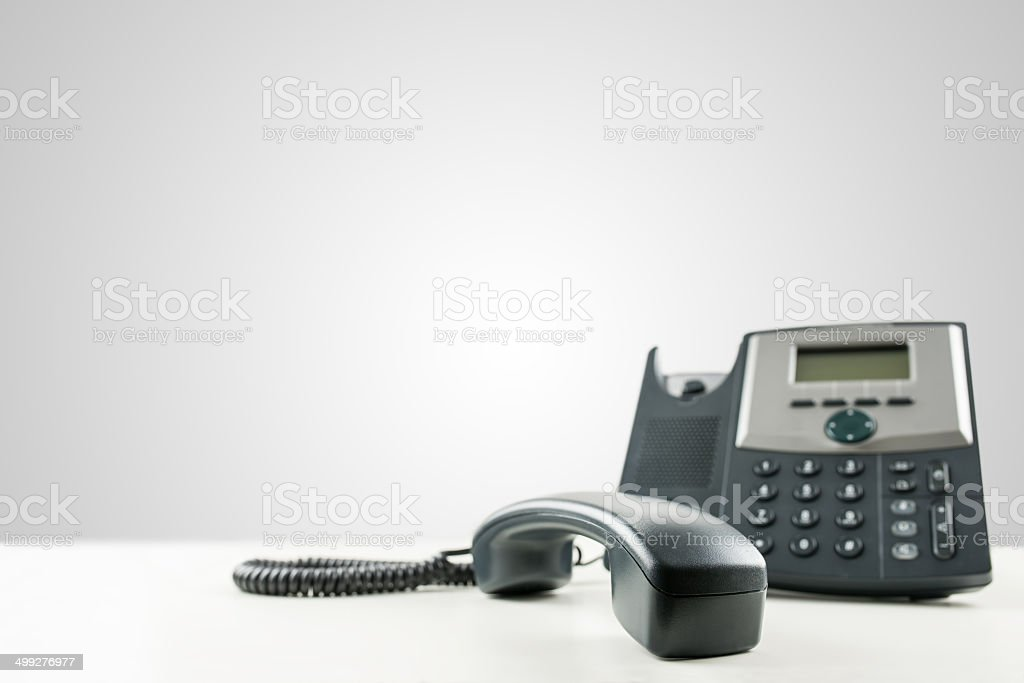 Landline Telephone With The Receiver Offhook Stock Photo