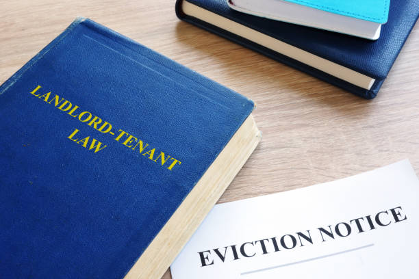 landlord-tenant law and eviction notice on a desk. - tenant stock photos and pictures